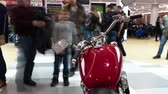 Lipetsk, Russian Federation - Jan 13, 2018: Exhibition of motorcycles, Timelapse video in the foreground of the red motorcycle Stock mozgókép