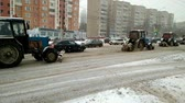 arando : Lipetsk, Russian Federation - January 20, 2018: A team of tractors to clean the roadway of snow from in snowfall