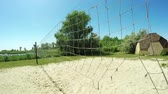 voleibol : Old volleyball net on river bank