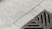 gutter system : On granite tiles with heavy rain dripping gutter