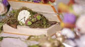 christmas fragrances : At the wedding table clocks are decorated with flowers and vines Stock Footage