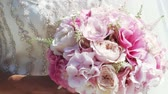 meal : Beautiful wedding bouquet in hands of bride Stock Footage