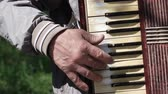 accordionist : Old man plays on old accordion