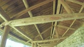 battlements : Wooden carport on wall Stock Footage