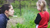 sister : Girl playing in garden Stock Footage