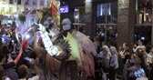 stilts : Dancers on stilts in suits of big birds and with equestrians in turbans and pilgrims with drummers Stock Footage