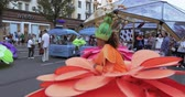 palafitte : Dancers on stilts in suits of colorful large flowers