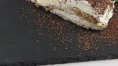 bolo : Tiramisu dessert cake with strawberry on black slate tray Vídeos
