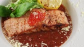 delicadeza : Salmon in red tomato sauce with caviar in white plate