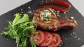 schab : Grilled pork chop with vegetables and tomato sauce