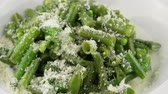 green onion : Asparagus in cream sauce and Parmesan cheese in white plate