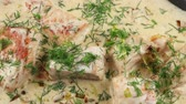 leeks : Fish soup with salmon, cream and parsley in a frying pan Stock Footage