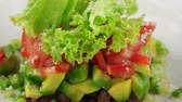 уксус : Salad with veal, tomatoes and avocado, closeup (loop)