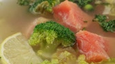 citrus fruit dish : Fish soup with salmon and broccoli in white plate