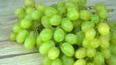 виноград : green grape rotating closeup slow motion 4k, on wood