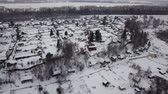 Aerial photography. Winter. Village. The kopter rises up at a 45 degree angle. In the center of the frame is a beautiful wooden house. Stock Footage