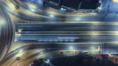 Hyperlapse timelapse of night city traffic on 4-way stop street intersection circle roundabout in bangkok, thailand. 4K UHD horizontal aerial view.