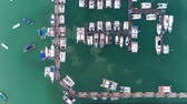 Time-lapse pier speedboat. A marina lot.Yacht and sailboats moored at the quay. Aerial 4k cinematic helicopter view . Top view harbor