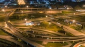 timelapse of night city traffic on 4-way stop street intersection circle roundabout in bangkok, thailand. 4K UHD horizontal aerial view. Archivo de Video