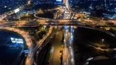 Aerial shoot top view circle road Traffic in city at night, 4K, time lapse, bangkok, thailand.