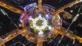 patron abstracto : Hyperlapse timelapse moving go right circular of night city traffic on 4-way stop street intersection circle roundabout in bangkok thailand at night, 4K UHD horizontal aerial view.