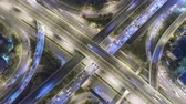 Aerial top view zoom in intersection road traffic in city at night, 4K, time lapse, bangkok, thailand. Archivo de Video