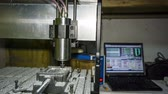 lakatosmunka : RAW format:  metal lathe with numerical control is cutting aluminium at workshop.