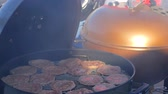 Turning the cutlets on the grill Stock Footage