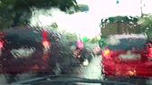 Rain drips onto the car glass, Windshield wipers wipe rain drops Stock Footage