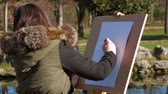 paint : Young Girl Drawing Picture In Park