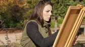 Portrait Of Young Girl Drawing Picture In Park Stock Footage