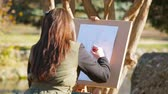 Young Girl Drawing Picture At Nature