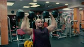 Man Does Heavy Bench Press With Dumbells
