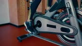 Beautiful sporty brunette Woman of average years Training On Exercise Bicycle In The Gym.