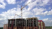 Construction of the building on the background of sky and clouds time lapse.  Under construction apartments on background moving clouds, time-lapse, the construction of a multistory apartment building.