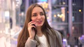 shoppingbag : Young girl with long hair talking on the phone in the Mall. Shopping. Stock Footage