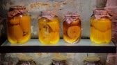 conservado : Vegetables banks. Jars with pickled vegetables and on glass shelf Stock Footage