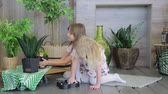 дошкольник : Two girls playing in the room decorated with green plants. Two girls sisters having fun