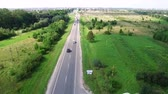 szállít : Aerial Flight drone over the road. The movement of cars on the road from the height