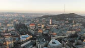 Flight over the central part of the city of Lviv in Ukraine. Morning sunrise over the city. Beautiful panorama of the morning city.