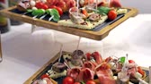 banquette : Buffet table. Sandwiches with sausage, tomato and mozzarella. Delicious snacks on the Banquet table