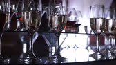 elevação : The mans hand takes a glass with a drink. Funchal table with wine glasses Stock Footage