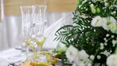waiter : Fully decorated table with refined dishes. Ready to start celebrations. Server table
