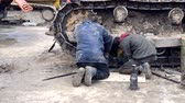 dredger : An employee repairs a bulldozer. Repair of heavy construction equipment at the construction site Stock Footage
