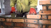 bricklayer : Bricklaying. Hands that put a brick on a construction site