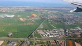 тюльпаны : View from the window of the plane to Holland. Green fields and fields of tulips from the plane window