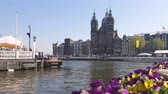 contemporâneo : Amsterdam, Netherlands. 25.04.2019. The Basilica of St. Nicholas in Amsterdam filmed from the waters of a canal. Amsterdam Netherlands. Push in shot.