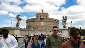 天使 : ROME. ITALY. May 21, 2019 Group of tourists on the bridge in front of the castle. Castel Sant Angelo or Mausoleum in Rome Italy. Tourist place of Rome. 動画素材