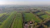 jellegzetes : Aerial view small beautiful village in Holland. Flying over the roofs of houses and streets of a small village in Holland. Stock mozgókép