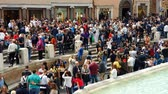 örök : ROME. ITALY. May 21, 2019 A large number of tourists near the fountain Trevi Fountain, the famous Baroque fountain and one of the most visited attractions of Rome. Stock mozgókép